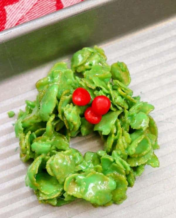 Wreath shaped Christmas cookie with red candies for decoration