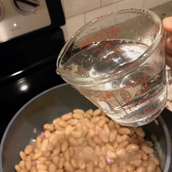 Add water to the homemade bean soup
