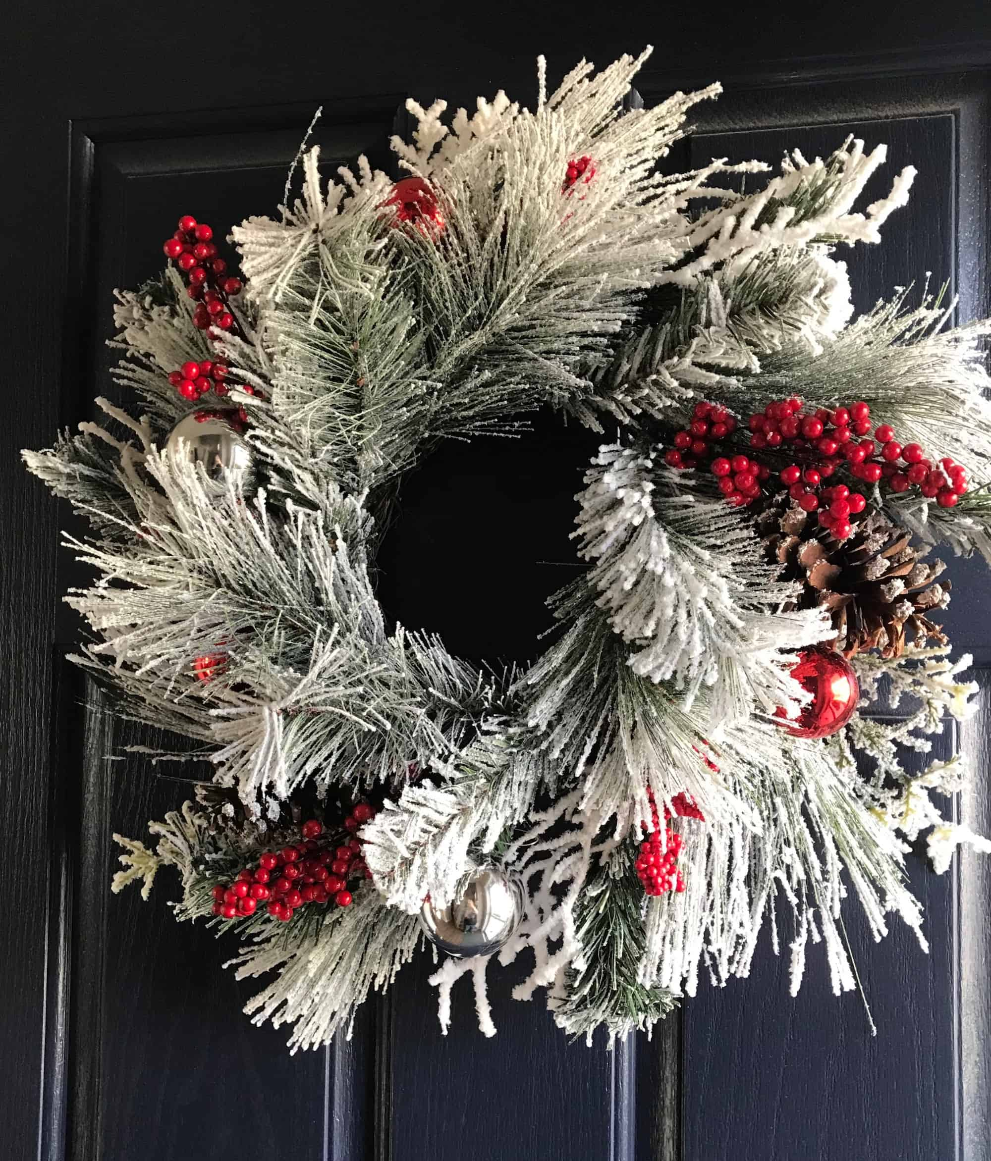 Flocked Christmas wreath with red berries