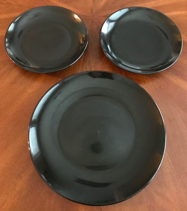 1 black dinner plate and 2 black salad plates