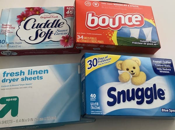 4 boxes of dryer sheets with Bounce, Snuggle, and 2 store brands