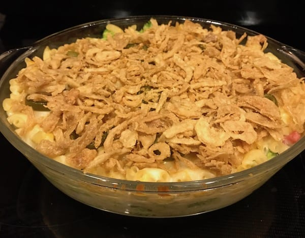Mac and cheese casserole topped with fried onions.
