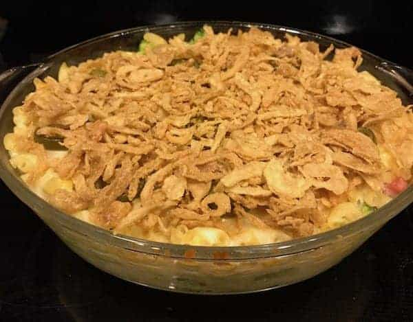Mac and cheese casserole with ham, jalapeños, and fried onions.