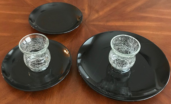Candleholders glued to the center of the plates