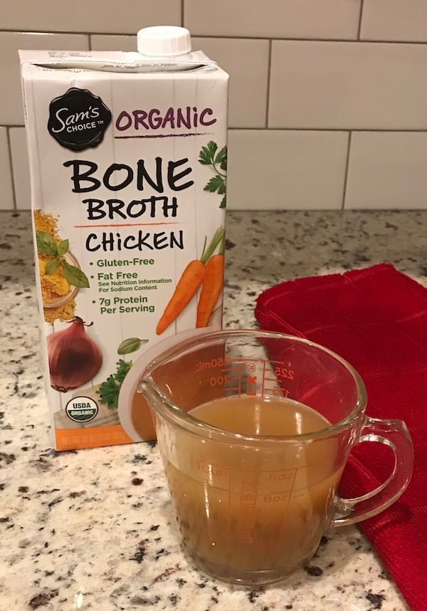 Package and measuring cup with chicken bone broth