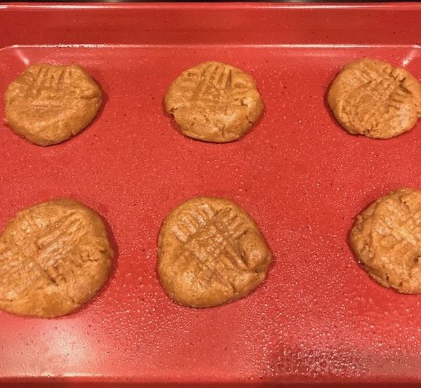 Cookies with crisscross on top, ready to be put in the oven.