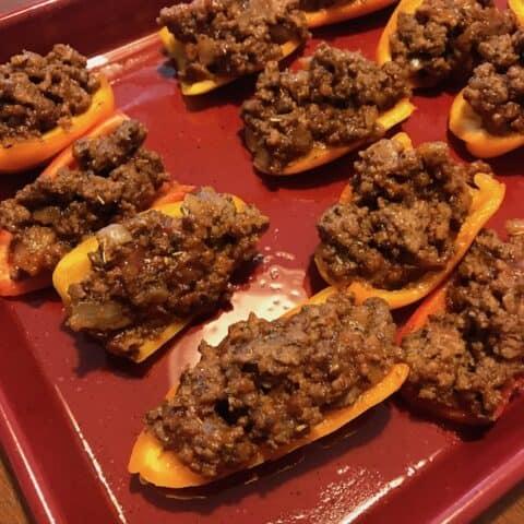Pan of mini stuffed peppers before baking