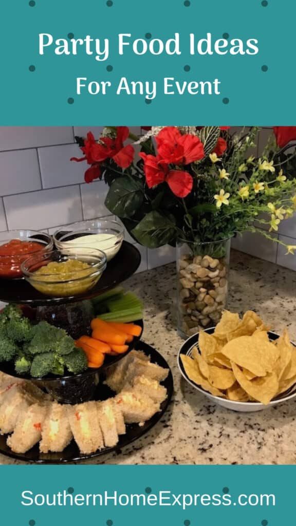 Party platters with sandwiches, dips, and chips