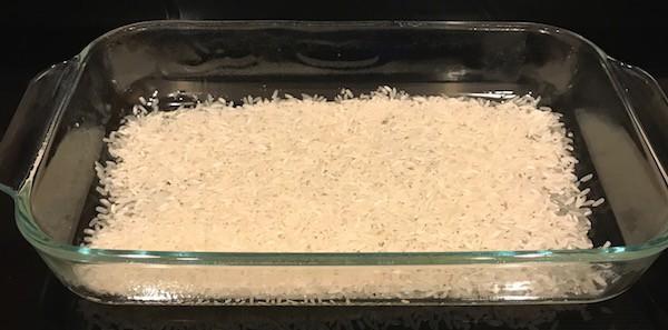 Evenly spread rice in bottom of sprayed casserole dish