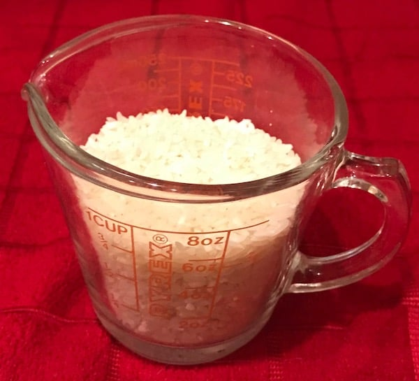 Measuring cup with rice