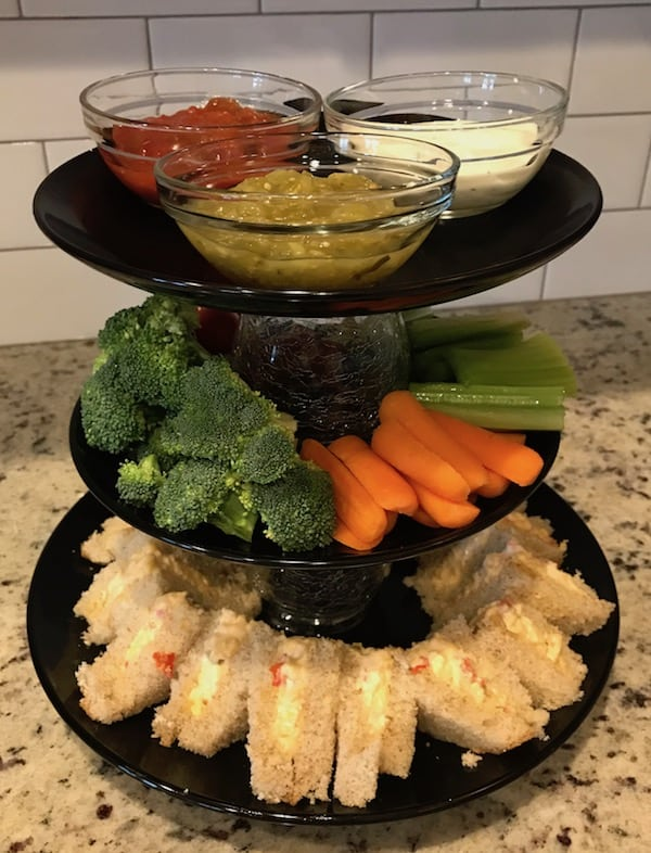 3-tiered party platter filled with pimento cheese sandwiches, vegetables, and dip