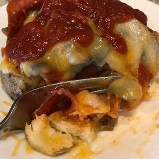 Cutting into the loaded Italian potato
