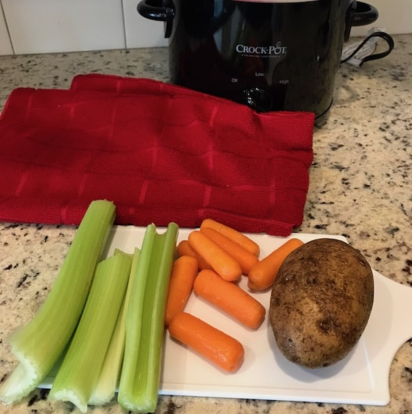 Celery, carrots, and potatoes ready to be cut for the Crockpot chicken stew