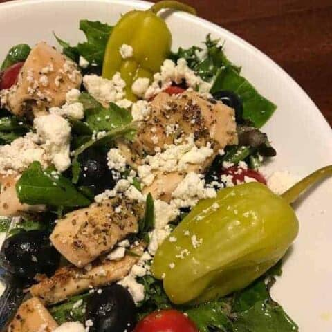 Mediterranean salad with chicken, vegetables, and feta cheese