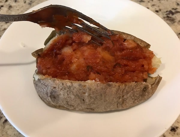 Italian sauce mixed into the inside of the potato