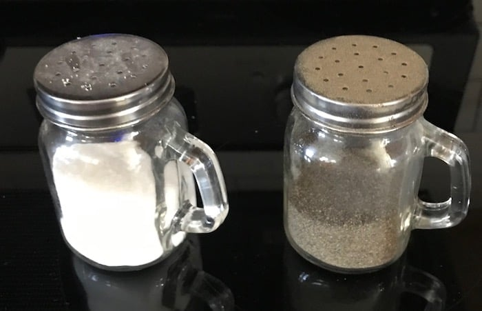 Clear glass salt and pepper shakers with handles