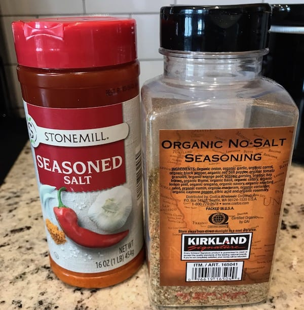 Containers of seasoned salt and organic seasoning for the Crockpot chicken stew