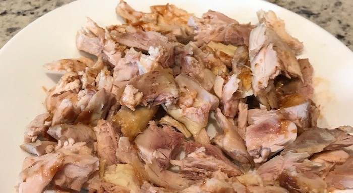 Plate of chopped cooked chicken
