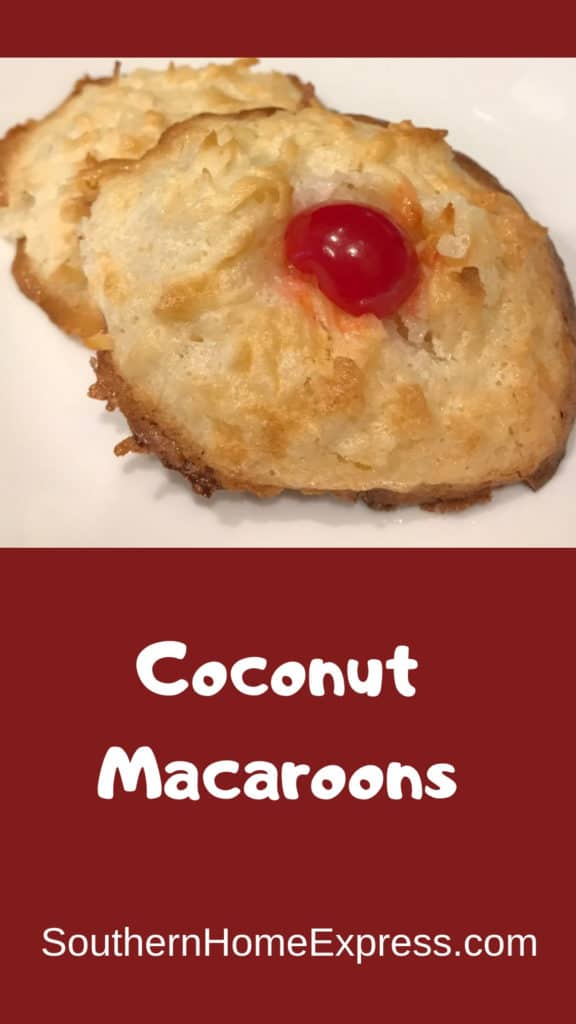 2 coconut macaroons with a cherry in the center