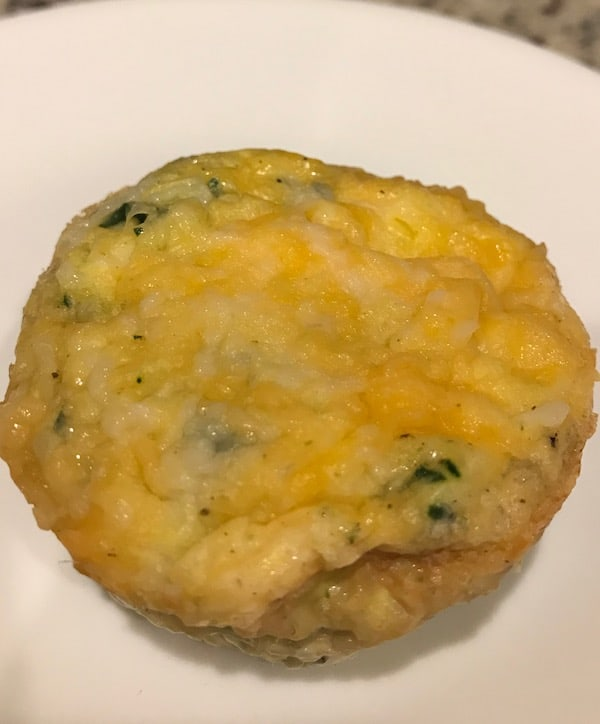 Vegetable and ham egg muffin cup on a white plate
