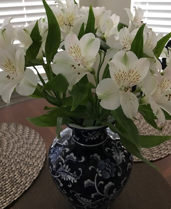 White alstroemeria in a blue and white vase brighten up a southern mama's table.