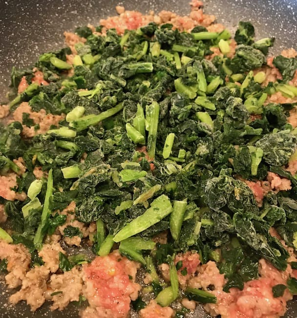 Add chopped kale to sausage.