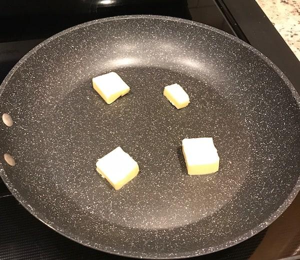 Melt butter in a large skillet.