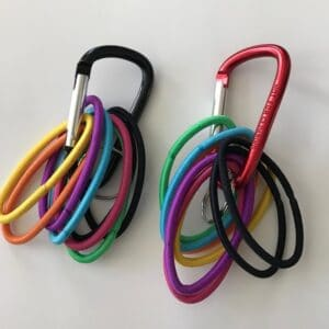 Organize ponytail holders by putting them on carabiners.