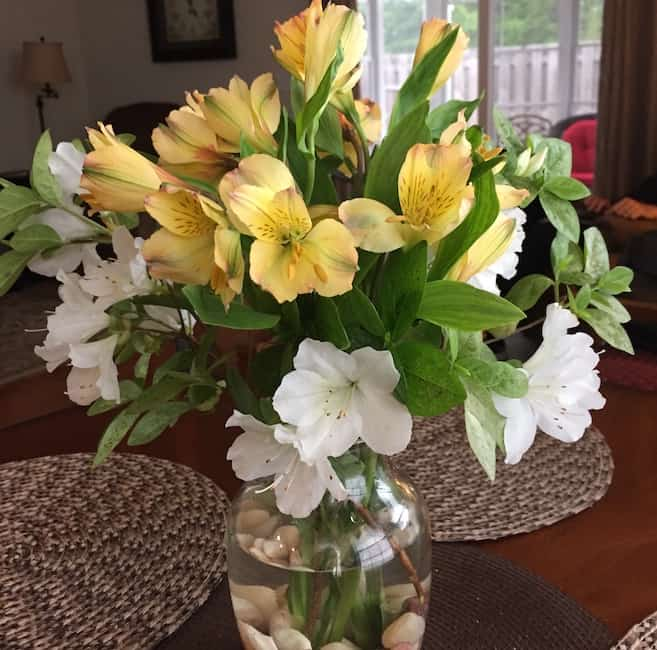 A southern mama tip is to use flowers for decorating. Get them from the yard or buy them at the grocery store.