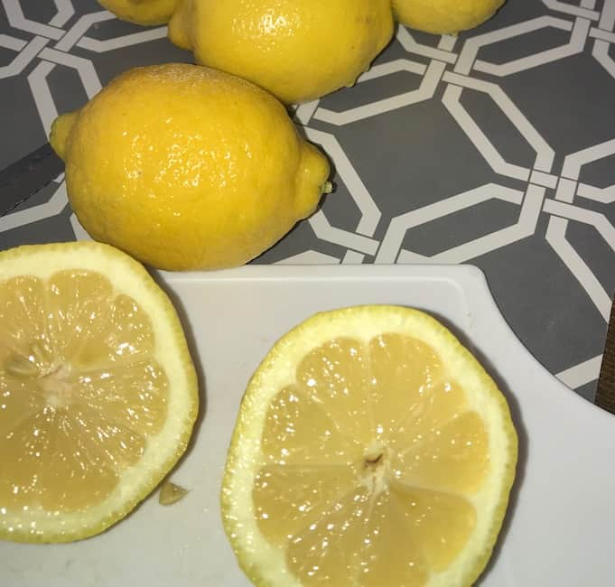 Lemon cut in half and ready to add to the lemonade smoothie