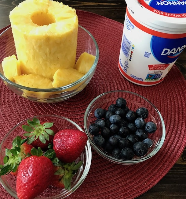 Fresh pineapple, strawberries, and blueberries are the perfect accompaniment to your favorite yogurt.