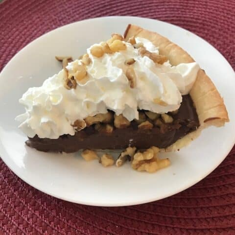 Slice of gluten free chocolate walnut pie
