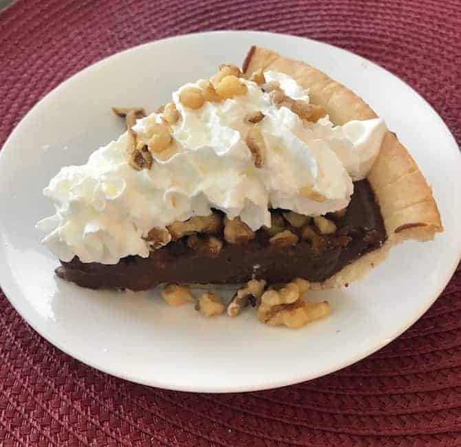 Slice of gluten free chocolate walnut pie