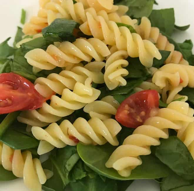 Zesty rotini pasta salad is a delicious addition to any meal.