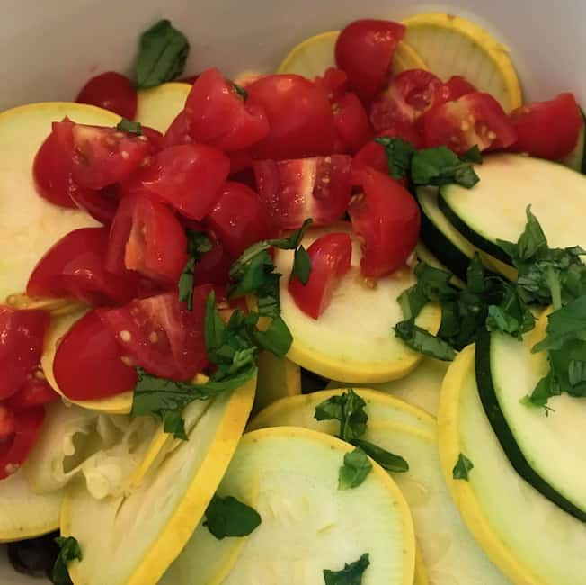 Add tomatoes and fresh basil to your squash and zucchini.