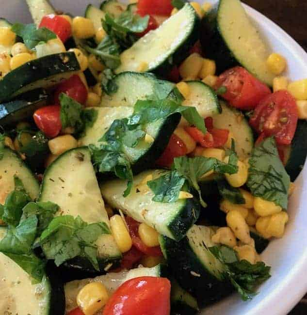 Chopped fresh basil adds the perfect finishing touch to this tomato cucumber corn salad.