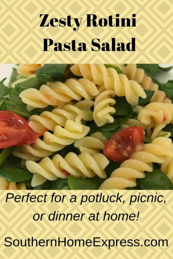Serving of zesty rotini pasta salad with greens and tomatoes