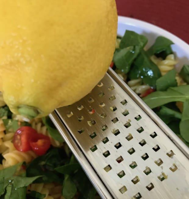 Zest some lemon over the zesty rotini pasta salad.