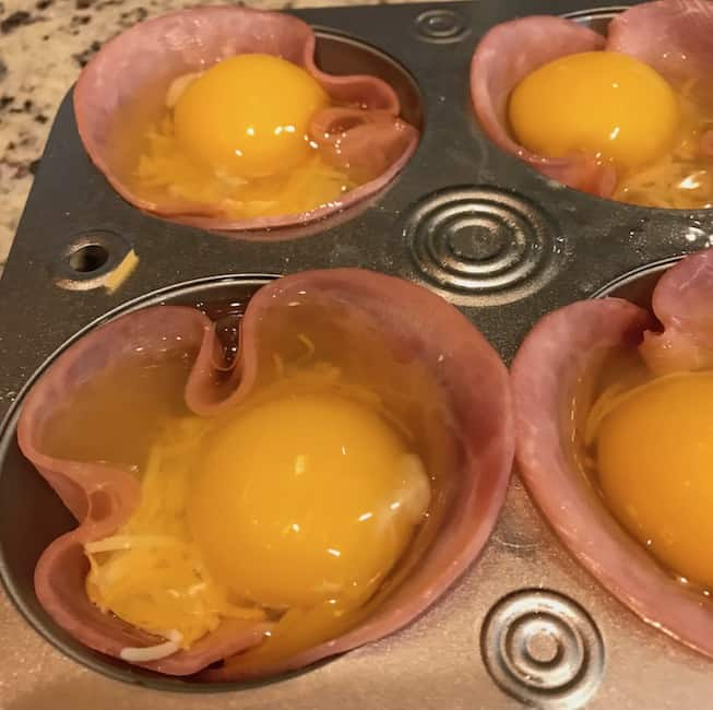 Eggs in the muffin tin with the ham and cheese.