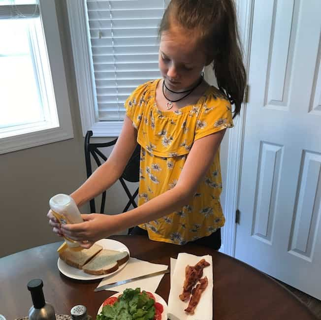 Making lunch is a fun thing to do with the grandkids. This granddaughter is making a BLT.