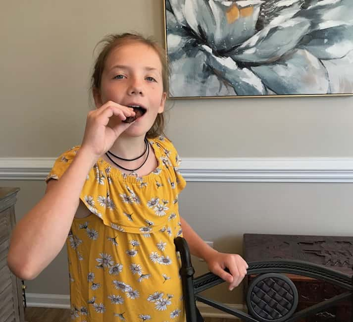 Granddaughter eating the treat she made.