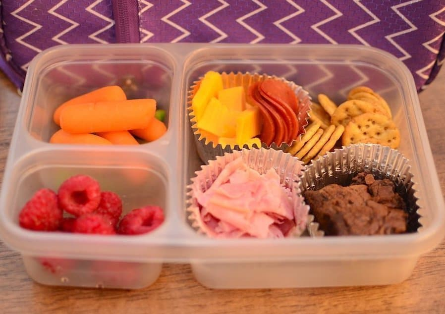 Divided containers with a variety of food for children's lunch