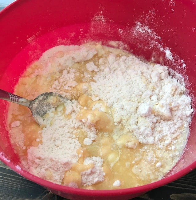 Cake mix, butter, and evaporated milk in a bowl