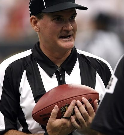 Football referee holding a football