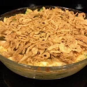 Mac and cheese casserole with ham topped with fried onions