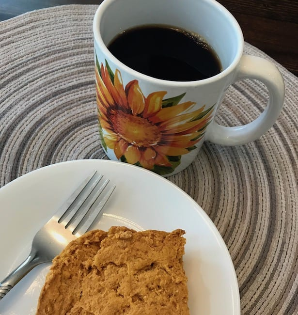 Slice of pumpkin cake and a cup of coffee