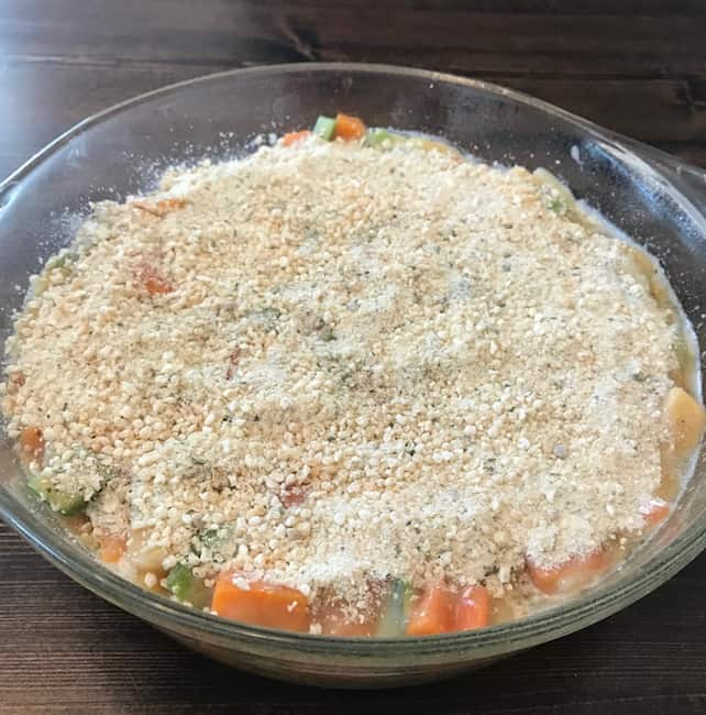 Creamy mixed vegetables topped with breadcrumbs in a casserole dish
