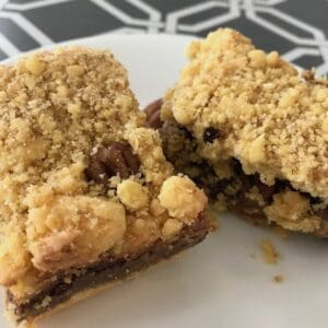 Chocolate caramel pecan bars on a plate