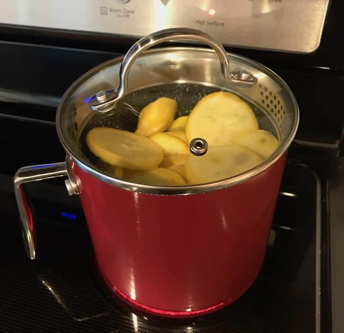 Steaming squash in a pot