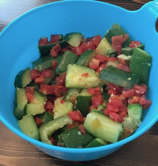 Mix the steamed zucchini and tomatoes